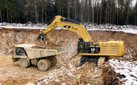 Cat 390F Hydraulic Excavator loading quarry truck
