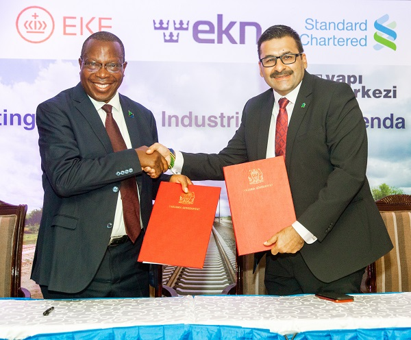 Standard Chartered CEO Sanjay Rughani with Minister of Finance and Planning Hon. Phillip Mpango02