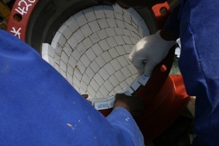 Multotec teams install pre-prepared ceramic chute work. (Image source: Multotec)