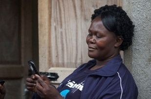 A distributer uploads the data she has collected and loaded on her Samsung smartphone. (Image source: Stephen Williams)