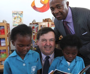 Western Cape Education Minister, Donald Grant, and Vincent Raseroka, Chairman of Chevron South Africa, along with Du Noon Primary School pupils