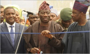 Aliko Dangote, president of Dangote Group (left), alongside Nigerian President, Goodluck Jonathan at the opening ceremony