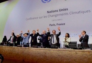 French Foreign Minister UN Secretary General Ban and French President Hollande Raise Their Hands After Representatives of 196 Countries Approved a Sweeping Environmental Agreement at COP21 in Paris 23076185